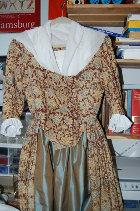 An old gown, with new sleeve ruffles and petticoat.