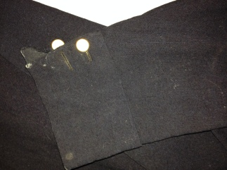 Slit cuff with two buttons, RIHS Museum Collections, 1968.38.1
