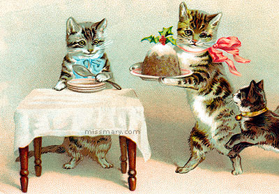 postcard of kittens eating christmas pudding