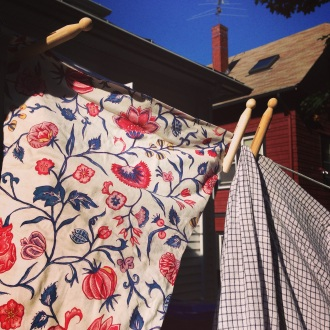 chintz and checked clothes on a  clothesline