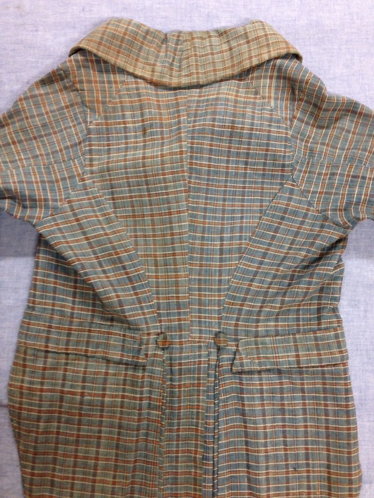 "1967.13.17, back view of ""Stonington Plaid"" checked linen coat. Gift of Mrs Muriel Buckley, URI Textiles Collection."