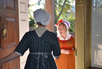 Our new maid, Eliza, greets the mantua maker
