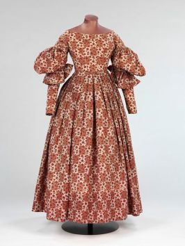 Dress, England, Great Britain.  1836-1838. Printed wool, trimmed with printed wool, lined with cotton, hand-sewn Given by Mrs H. M. Shepherd, T.11-1935. Victoria & Albert Museum.