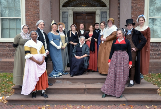 costumed interpreters on the steps of the John Brown House