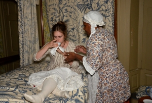 Goody Morris helps Alice drink lemon water to soothe her stomach. Photograph by J. D. Kay