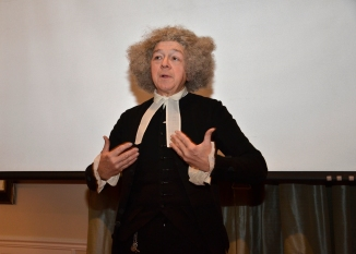 Reverend Hitchcock, hoping against hope that the tailor will one day finish his fine silk waistcoat. Photo by J. D. Kay