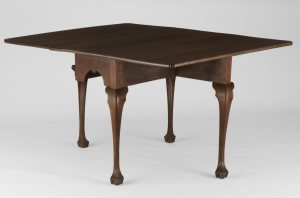 dark wooden drop leaf table with trifid feet